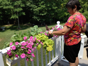 Standing Up at your deck railing too attend to flowers or herbs