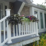 White planter made from a rain gutter.