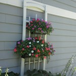 A trellis with planters made from rain gutters